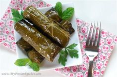 Grape leaves stuffed with meat and rice for a sweet and savory appetizer.