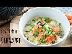 Warm and comforting homemade ochazuke with salted salmon, rice cracker, nori, and mitsuba. Make it with green tea or savory dashi.