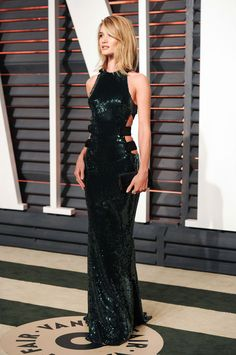 Rosie Huntington-Whiteley wore a long dark green Alexandre Vauthier sequin dress with cut outs - Vanity Fair Oscar Party. Celebrity style | glamour | gowns | afterparties