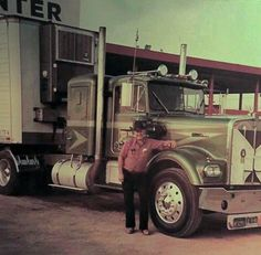 Buck Watson from Bakersfield. We've been great friends for 50 years Vintage Kenworth W-900A at a truck stop w/ owner operator.