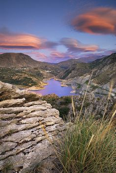 http://fineartamerica.com/featured/lenticular-clouds-at-canales-lake-guido-montanes-castillo.html
