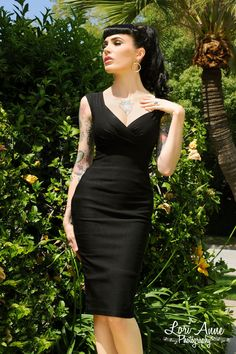 """Erin Wiggle Dress in Black Stretch Bengaline from Pinup Couture - Pinup Couture's Spring 2010 Collection takes its inspiration from classic shapes worn by screen icons of the 50s, but always with a modern, sexy woman in mind.  The Erin Dress has a gathered neckline, back zip, 7"""" back slit and is made of stretch bengaline."""