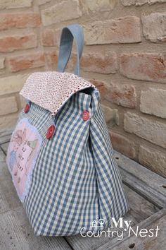 Me encanta ~ this pattern available as a PDF download from My Country Nest (under patterns tab)....... or Inspiration Overall I really like this design but for me would make the side vent a little wider for the top to allow for ease of access to the interior of the bag...... very cute