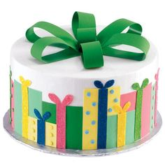 Gift Package Cake - Dazzling overlapping packages make this cake truly a gift! Presents made using Sugar Sheets! surround this gorgeous cake.