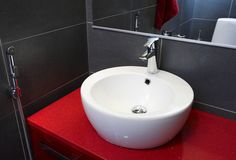 Oras Cubista washbasin faucet with a multipurpose handshower.