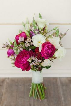 Lovely colors! Pink peonies, light pink waxflower, and white lisianthus and snapdragons.