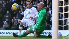 Luke Varney curls home Leeds' first goal against Tottenham in the Fourth Round of The FA Cup