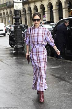 Chic: Victoria Beckham was seen cutting a stylish figure as she headed to the Martin Margi... #beckhams #victoriabeckham