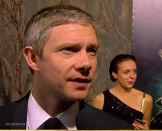 """In which the lovely Amanda Abbington suddenly realizes she is photo-bombing Martin's black carpet interview. We love you, Amanda!"" <3"