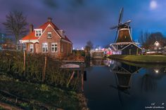 """Windmill """"De Passiebloem"""" Zwolle, the Netherlands. """"De Passiebloem"""" is a windmill that was built in 1776 for the commercial purpose of gaining oil from seeds and nuts. The mill like others was built near the river the Nieuwe Vecht."""