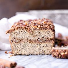 Paleo Cinnamon Streusel Banana Bread has a layer of pecan crumble! This gf + refined sugar free bread is sweetened with bananas.