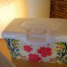 Dressed-Up Wet Wipes {tutorial}  I will publicly admit that I have cottonelle wipes on the back of my toilets and I want to do this to the containers.