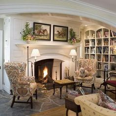 What's not to absolutely love about this picture? Horse pictures, a dog, a fireplace, and built-in bookshelves!