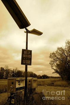 Obsolete and Forgotten www.jacquelineathmann.com  Gas Pump, gas station, station, Gasoline, Pumps, lighting, self service, engines, car, automobile, decay, aged, old, antique, vintage, grass, pavement, concrete, sepia, cloudy, sky, tree, trees, road, old school, old skool, manual, auto, lamp post, post, lamp, garrison, Minnesota, abandoned, rural, urban, city, country, fall, aged, forgotten, rot, rotten, broken, broken glass, nature, landscape, street, street lamp, branches, hose, hoses…
