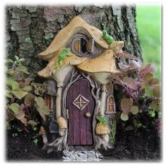 Three tiny frogs play leap frog on the mushrooms around the fairy door. Take a look at Leo the frog in our store he is a super fit with the Leap Frog Fairy Door! Leap Frog Fairy Door features a hinged Fairy Garden Doors, Fairy Garden Supplies, Fairy Garden Houses, Garden Gnomes, Fairy Gardening, Fairies Garden, Indoor Gardening, Opening Fairy Doors, Hobbit Garden
