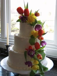I love the flowers, but the detail in the icing should be cut way back. There's so much going on with the flowers, the icing flourishes take away from the whole effect.