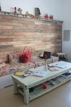 Pallet wall / storage seating--yes but I love the coffee table!