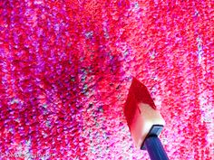 Dab paint on rug using sponge brush