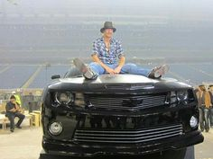 Kid Rock on his 40th bday present. A Camaro SS from Chevrolet.