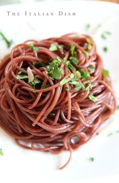 The Italian Dish {Here's a good reason to open a bottle of red wine - Drunken Pasta.  After slightly cooking your pasta in water, you finish cooking it in red wine.  It comes out a nice red color and very flavorful.}
