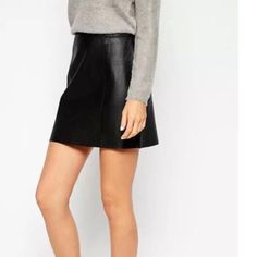 Lumière Black leather skirt Black leather skirt. Size large. Worn twice. Too big on me now. Perfect condition. Zipper on side. Lumière Skirts Mini