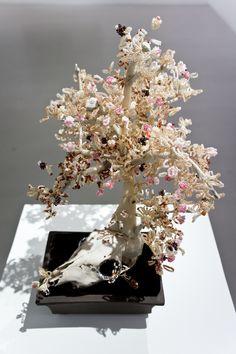 Haruko Maeda, Knockenbonsai 3, 2012, Animal skull, bones of pigs and chicken, beads, wire and ceramic, 42x28x38cm