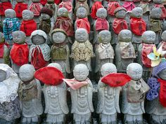 Jizo is the Buddhist god who is the guardian of the stillborn, miscarried and aborted foetuses in Japan.  These little statues of Jizo, call...