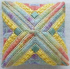 Canvaswork pincushion, space dyed threads, cushion stitch, norwich stitch, rice stitch, beading, diagonal satin stitch, double cross stitch.