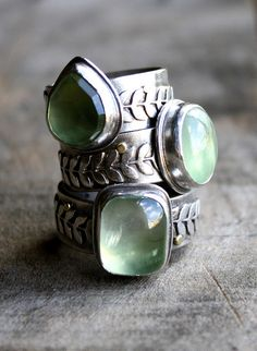 Woodland rings made of sterling silver and prehnite - a wide band adorned with a wreath of leaves and topped with an elf-green stone.
