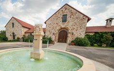 Stone barn with circle drive and fountain
