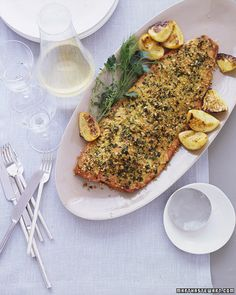 """This healthy fish dish is your anytime ally: It looks and tastes great, and it couldn't be faster or easier to prepare. You can serve it for a weeknight dinner or a weekend get-together in almost less time then it takes to set the table.A whole-salmon fillet has the same festive quality as roast beef or leg of lamb, and its a dish all your guests, including non-meat-eaters, will ooh and aah over."""" -- Allie Lewis Clapp, Deputy Food EditorEssential RecipeA salad is all you need to accompany..."""