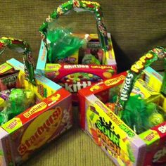 Why not save the money on the basket and make it out of candy, what kid doesn't love more candy? All you need is boxes of candy, a loopy candy to make the handle and some tape or glue