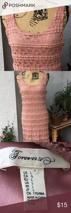 Forever 21 woman's crochet style tank dress blush Tank dress with scoop neck and back. Gorgeous blush color, it's more pink than it looks, the photo with the tag shows the closer color. Crochet like pattern from top to bottom. Form fitting, yet soft. Woman's size Large. Great Condition! Forever 21 Dresses Midi