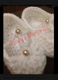 Soft baby booties with pearl button. These are a custom made order.  https://www.facebook.com/JaiseysMemories?ref=hl