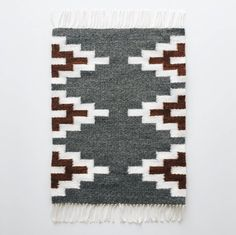 Handwoven mat made with natural wool fibers. Perfect for a table, shelf, or desk to add that simple touch of decor. Colors: Gray, White, & Amber Brown Length (including fringe): 19 Width: Made from: wool and cotton Navajo Weaving, Weaving Art, Tapestry Weaving, Loom Weaving, Motif Navajo, Navajo Art, Loom Knitting Patterns, Weaving Patterns, Knitting Tutorials