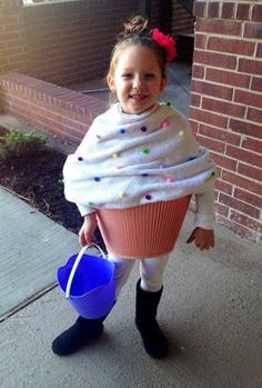 DIY Cupcake halloween costume for kids using a blanket, pom poms, and an upside down lampshade. Genius!