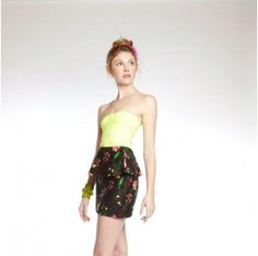Peplum Skirt in Black Floral is ethically sourced and sewn in Ghana.