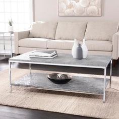 Whip your style into shape with this modern coffee table with storage. Plated metal gives this cocktail table a reflective, metallic look, while two levels double storage space for minimalist decor or magazines. A faux marble top and storage s Faux Marble Coffee Table, Stone Coffee Table, Coffee Table With Shelf, Concrete Coffee Table, Modern Coffee Tables, Living Room Sofa, Apartment Living, White Table Top, Minimalist Decor