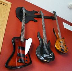 Decorative multi-guitar hangers by www.WallAxe.com
