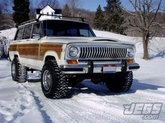 """JEGS Customer, Aaron Easter, shared this photo of his 360-AMC-powered 1988 Jeep Grand Wagoneer with a Cherokee Chief grill conversion. It rides on Mickey Thompson Performance Tires & Wheels Classic IIs and Baja MTZs and has a 4"""" lift. Would you have fun driving it this winter?"""