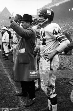 New York Giants Kyle Rote (44) and head coach Allie Sherman on sidelines during game vs Philadelphia Eagles at Franklin Field. Neil Leifer F27 )