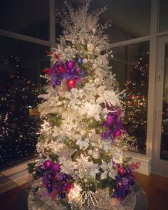 My Christmas tree this year, inspired by my wedding colors: silver, violet, pink & purple!