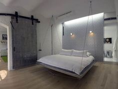 floating beds are SOOOO COOL! but i would be paranoid that it would fall our of the ceiling...