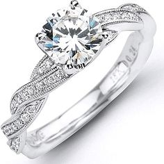 Simon G Pave-Set Diamond Twist Engagement Ring  : This stylish engagement ring setting by Simon G features round brilliant side diamonds which are pave-set on a twisted band that is finished off with a milgrain edge.