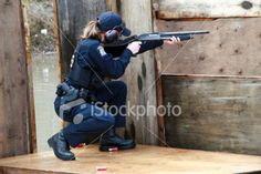 American Women Police Officers | Women police officer shooting shotgun Royalty Free Stock Photo