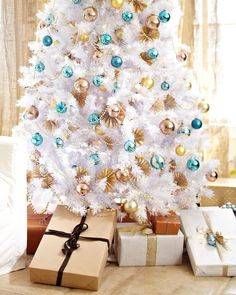 White Christmas Tree with blue and gold decorations.