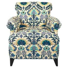 "Bring bohemian flair to your home with this multicolor arm chair, showcasing tapered legs and a vibrant floral-inspired damask motif. Made in the USA.      Product: ChairConstruction Material: Alder wood, high density foam and cottonColor: Blue floralFeatures:  Nailhead trimTapered legsMade in the USASpring seatingDimensions: 33"" H x 33"" W x 35"" D"