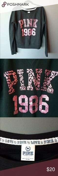 VS PINK 1986 rhinestone sweatshirt PINK 1986 black rhinestone sweatshirt. Preowned and in good condition- some fading from washing and wearing, 1-2 missing stones but still a cute and cozy sweatshirt! This is a size large. PINK Victoria's Secret Tops Sweatshirts & Hoodies