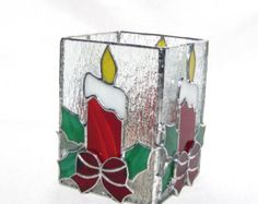 Do you know someone whos having a December wedding? This Mr. and Mrs. Snowman is the perfect decoration for the reception table. It makes an adorable decoration for anybody for the holidays, no matter what theyre doing. It stands alone and is designed to hold a short candle behind the snowman and woman. I created this candle holder of 26 hand cut pieces of stained glass and one piece of mirror. The main layer includes the snow peoples body and their hats. On top of this are both scarves, the…
