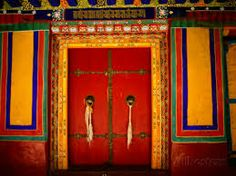 Tibeten Monastry door draws you in with the warmth of reds and yellows